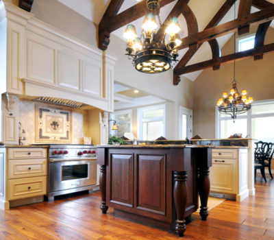 Kitchen With White And Dark Cabinetry And Vaulted Ceiling With Beams, Dark-stained Kitchen Cabinetry, DuraSupreme Kitchen Cabinetry, Dark-stained Kitchen Island