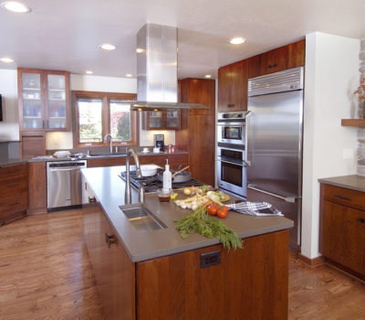 Spacious Kitchen Remodel With Stained Dura Supreme Cabinets And Stainless Steel Appliances