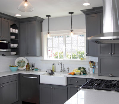 "Gray And White Kitchen Remodel With Teal Blue And Yellow Décor Accents Featuring Dura Supreme Cabinetry's ""Storm Gray"" And ""Classic White"" Cabinets"