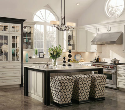 Large Open Kitchen With White Cabinets And Black Accents