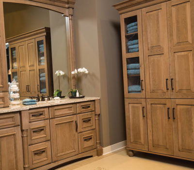 Dura Supreme Bathroom Cherry Cabinets And Vanity Shown With The St. Augustine Panel And Lancaster Cabinet Door Styles Both With A Cashew Stained Finish.