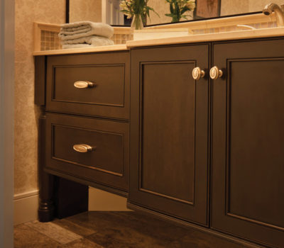 Dura Supreme Bathroom Vanity Cabinets Shown With The Madison Cabinet Door Style In Cherry With Peppercorn Stain Finish.