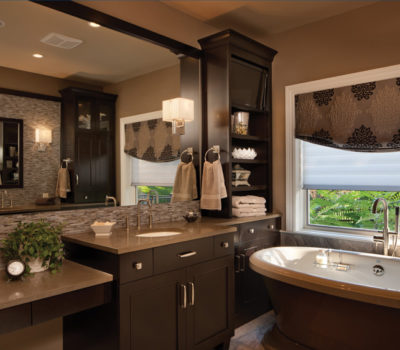 Dura Supreme's Bath Cabinetry Shown With The Silverton Cabinet Door Style In Cherry With A Cocoa Brown Stained Finish.